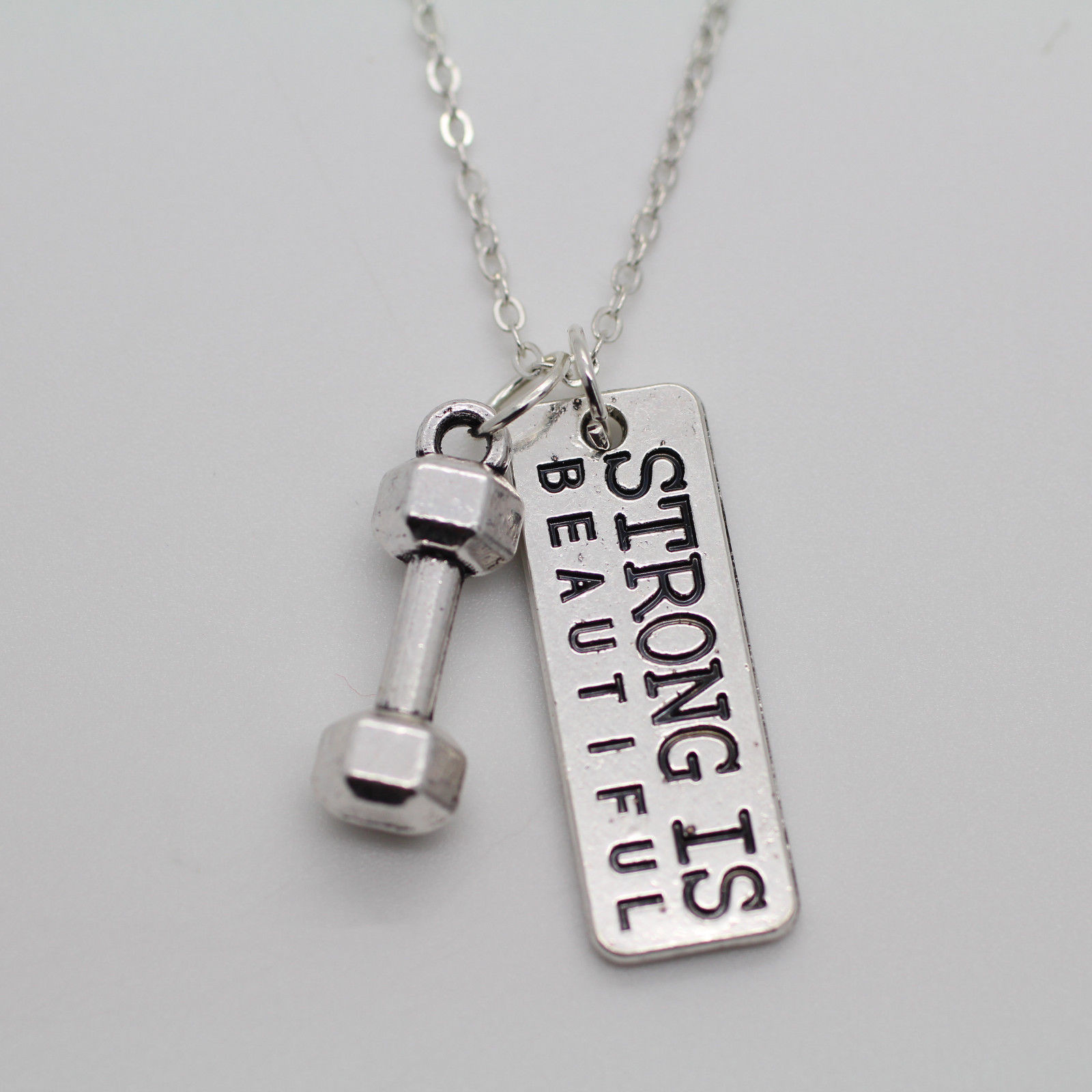 """Strong Is Beautiful"" Dumbbell Charm Necklace"